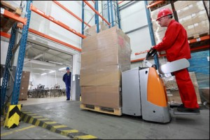 warehouse worker operating machinery