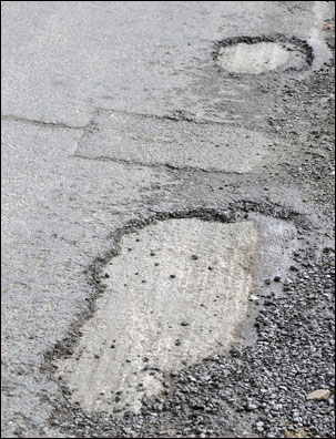 pothole in parking lot